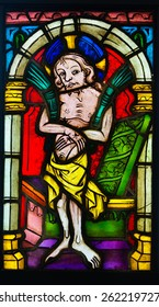 GLASGOW, SCOTLAND - MARCH  19, 2015: Stained glass panel made  in Austria in the late 14th Century, depicting Christ as the Man of Sorrows, exhibited in The Burrell Collection
