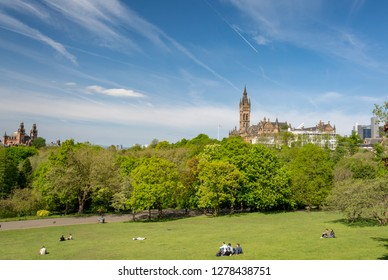 Glasgow, Scotland - May 19, 2018: Kelvingrove park in spring; People enjoying the sunny days in Kelvingrove park; view towards Glasgow University and Kelvingrove museum on May 19, Glasgow, Scotland