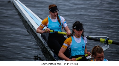 Glasgow, Scotland - May 25 2019: Edinburgh University rowing team on the river Clyde during the Scottish Boat Race.