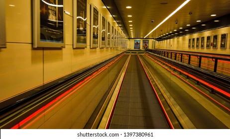 Glasgow, Scotland; May 4th 2019: View down a long walkway at Buchanan Street Subway station.