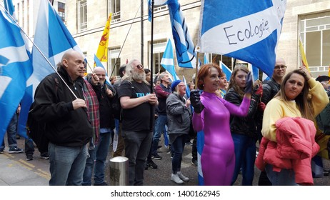 Glasgow, Scotland; May 4th 2019: Independence for Scotland march. Marchers waving the Scottish flag, the Saltire.