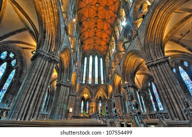 GLASGOW, SCOTLAND - MAY 7: Stone pillars, pews, and wooden vaulting of St Mungo's Cathedral on May 7, 2012 in Glasgow