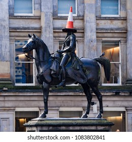 Glasgow, Scotland - October 04 2014: The Duke of Wellington Statue in Glasgow showing the Traffic Cone which is nearly always put on his head