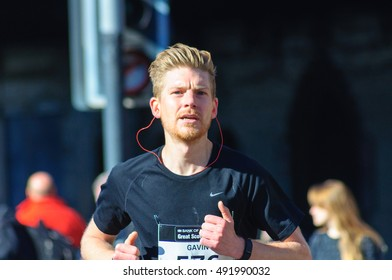 GLASGOW, SCOTLAND - OCTOBER 2, 2016: Runner competing in the half marathon on the city streets during The Great Scottish Run