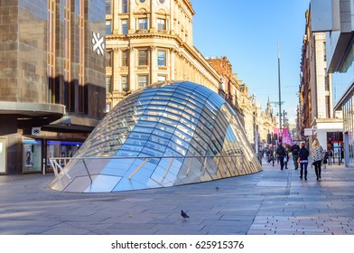 GLASGOW, SCOTLAND - OCTOBER 9, 2016: St. Enoch Square, Glasgow, Scotland. underground entrance, cobbled pavement, surrounding shops, trees, daytime.