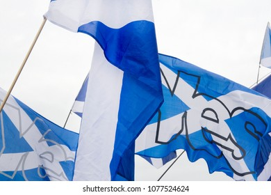 GLASGOW, SCOTLAND -SEPTEMBER 14th 2014: Two Saltire flags with the word 'YES' on it at the BBC Scotland HQ.