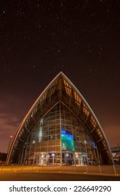 GLASGOW, SCOTLAND - SEPTEMBER 17, 2014: the Clyde Auditorium lit up at night on November 03, 2014 in Glasgow, Scotland. The Clyde Auditorium opened in 1995.