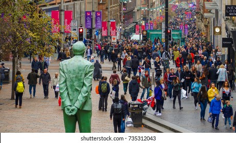Glasgow, Scotland, UK; 15 October 2017: Pedestrians on a busy Buchanan Street in Glasgow City Centre, Scotland, UK. With the statue of Donald Dewar in the foreground.