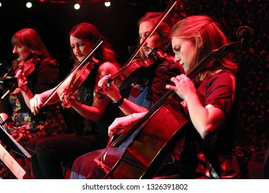 GLASGOW, SCOTLAND, UK : 29 JANUARY 2019 : Southern Fried String Quartet play live with Grammy nominated Nashville singer songwriter Gretchen Peters during Celtic Connections at Kings Theatre, Glasgow