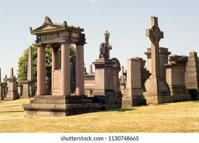 Glasgow, Scotland, UK - July 1 2018: Monuments and tombstones at the Glasgow Necropolis, a Victorian cemetery in Glasgow, Scotland, UK