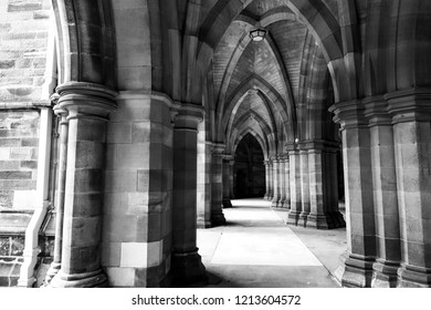 Glasgow, Scotland, UK; October 14th 2018:  The Cloisters between the quadrangles at Glasgow University. Black and white image.