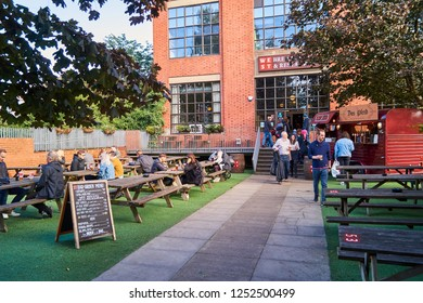 Glasgow, UK: 22 September 2018 - People enjoy food and drink outside the popular restaurant and brewery in Glasgow called WEST on the green.