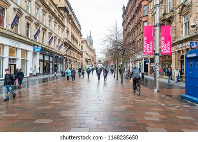 Glasgow, UK - March 07, 2018: People Strolling along Buchanan Street on a Cloudy Day. Buchanan Street is the city's main pedestrian boulevard lined with architectural gems and shops.