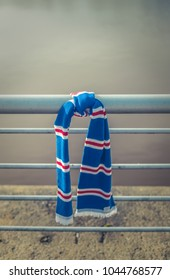 GLASGOW, UK - MARCH 11th 2018: A Rangers Football Club scarf tied to a railing beside the river Clyde in Glasgow, Scotland after the Rangers versus Celtic match on March 11th, 2018.