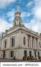 Glasgow, UK - September 4, 2019 - Early 19th century Hutchesons' Hall, or Hospital with distinctive octagonal spire adorned with a clock and dial plate on on Ingram Street, Glasgow, Scotland