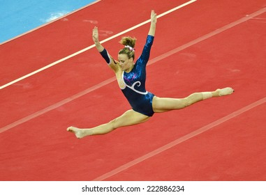 GLASGOW, UNITED KINGDOM - JULY 30: unidentified Scottish gymnast on Floor in Ladies All Around B Final at Commonwealth Games in SSE Hydro on July 30, 2014 in Glasgow, United Kingdom.