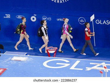 GLASGOW, UNITED KINGDOM - JULY 30: gymnasts are led towards the Uneven Bars in the Ladies All Around B Final at Commonwealth Games in SSE Hydro on July 30, 2014 in Glasgow, United Kingdom.