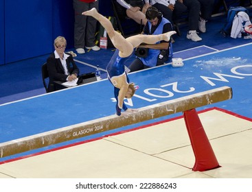 GLASGOW, UNITED KINGDOM - JULY 30: unidentified Scottish gymnast on Beam in Ladies All Around B Final at Commonwealth Games in SSE Hydro on July 30, 2014 in Glasgow, United Kingdom.