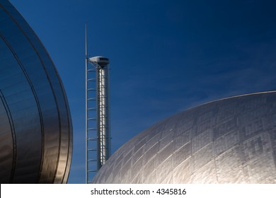 Glasgow's observation tower framed between two titanium buildings