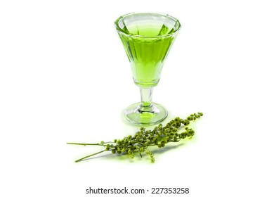 Glass of absinthe with a sprig of tarragon