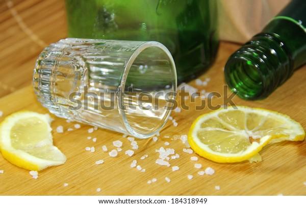 Glass of alcohol and lemon