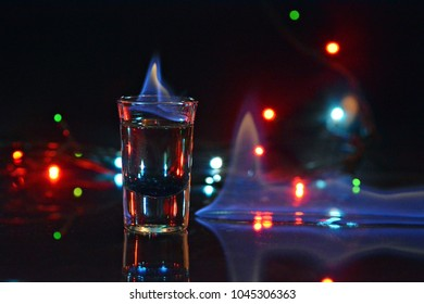 glass of alcohol on fire