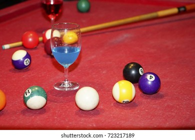 The glass of alcohol place on the snooker table .
