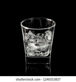 glass for alcohol with pure ice isolated over black background