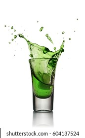Glass of alcoholic drink with ice isolated on white background. Absinthe or mint liquor shot