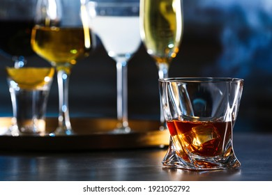 Glass of alcoholic drink on table, closeup. Space for text