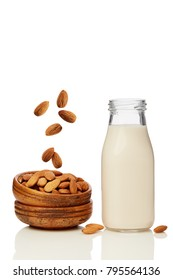 A glass of almond milk and a bowl of almonds