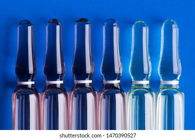 Glass ampoules close up. Medical ampoules. Medical ampoules on a blue background.