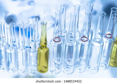 Glass ampoules for medicines. The ampoules are ready to be filled and sealed. Manufacture of drugs for injection. Production of medical products from glass. Pharmacology.