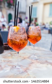 Glass of Aperol Spritz cocktail on the table in restaurant, famous refreshing drink, Italy.