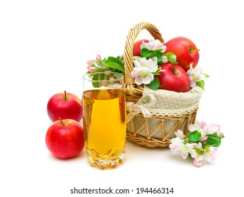 glass of apple juice and a basket of red apples on a white background. horizontal photo.