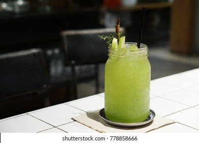 A glass of apple juice mixed with lime, Colorful cocktail or tropical mocktail, Homemade green detox juice for healthy drink concept.