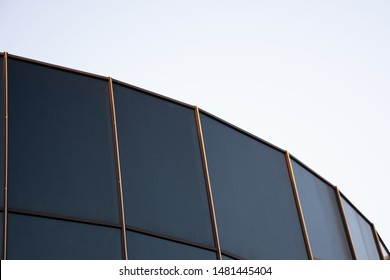 Glass architecture. Double-exposure tilt photo of contemporary office building facade