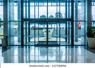 Glass automatic sliding doors entrance into shopping mall
