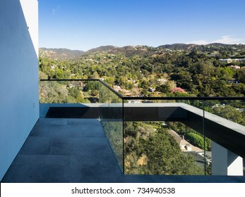Glass balcony rail with exterior valley view