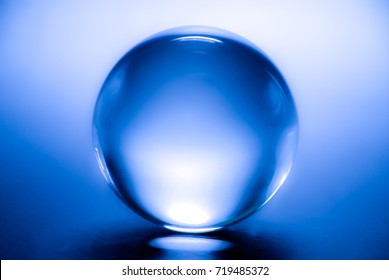 Glass ball in blue. Crystal ball in abstract blue. Magic ball.