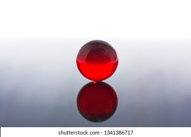Glass ball in red. Crystal ball in abstract red. Magic ball.