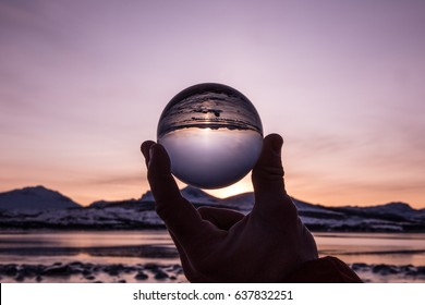 Glass ball reflection of mountain sunset