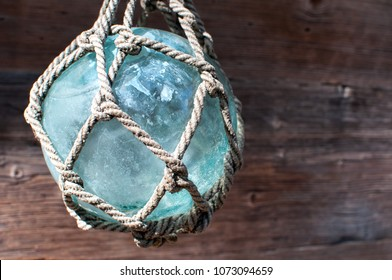 Glass ball in rope braid used as a float for fishing nets