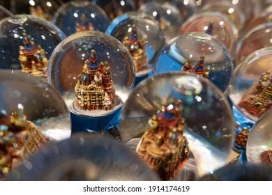 A glass ball with snow and a castle inside - a souvenir from a trip in a gift shop