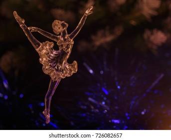 Glass ballet dancer on Dark background. Old style. Selective focus