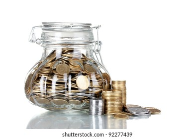 Glass bank for tips with money isolated on white. Ukrainian coins