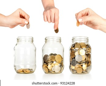 Glass banks for tips with money like diagram and hands put coins isolated on white