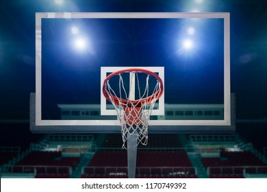 Glass basketball board and hoop in an arena