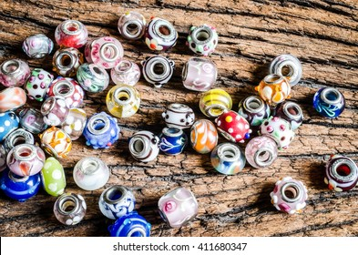 glass beads on wooden