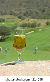 Glass of beer after a game of golf